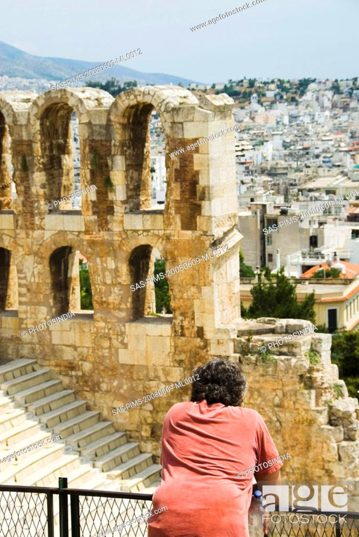 Stock Photo: Tourist in an ancient amphitheater, Theatre of Dionysus, Acropolis, Athens, Greece.