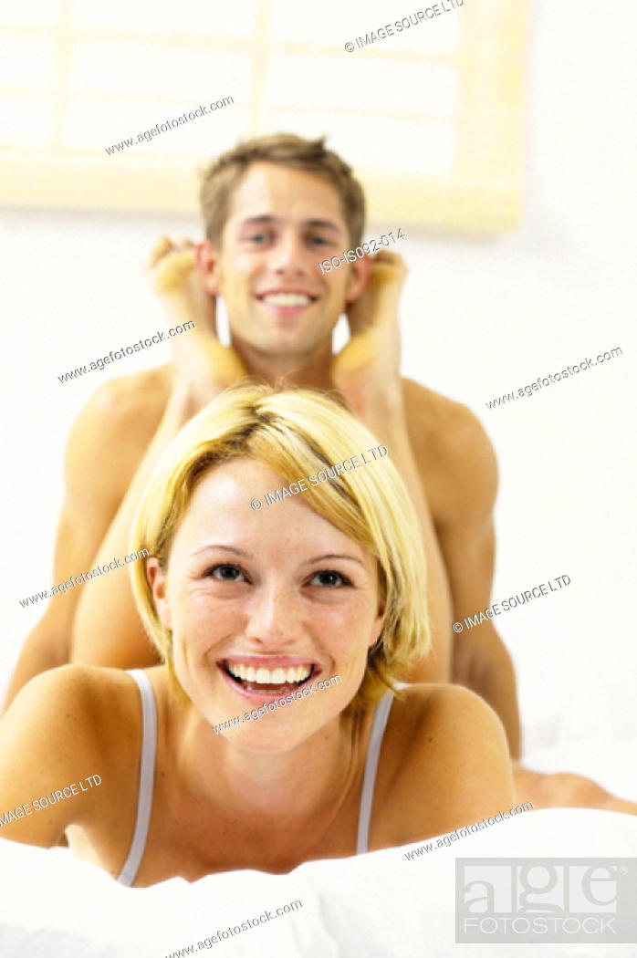 Stock Photo: Couple on bed together.