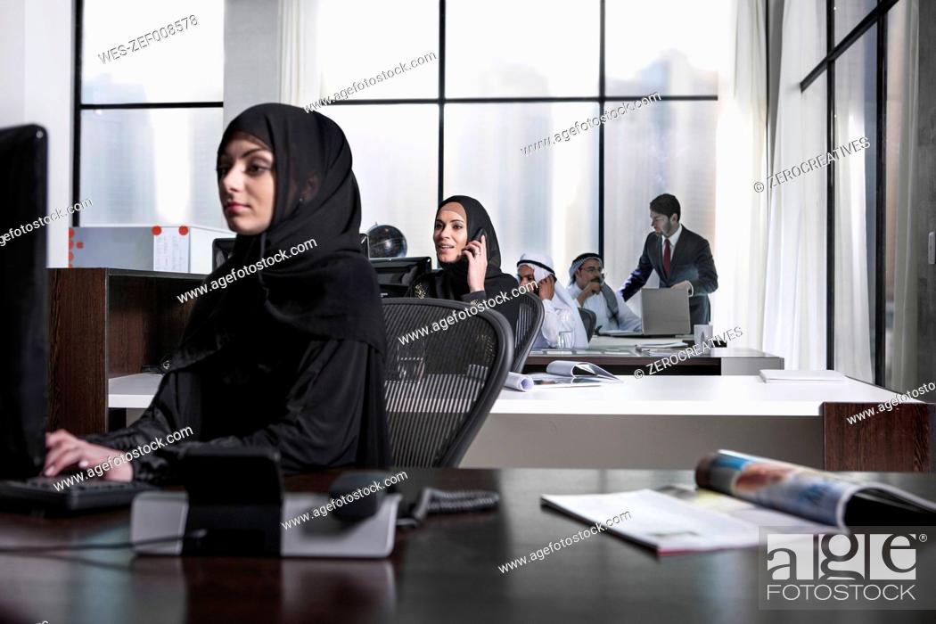 Stock Photo: Middle Eastern businesswomen working in office.