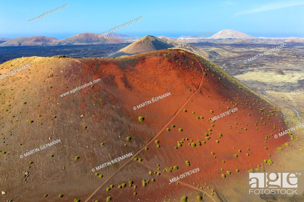 Stock Photo: red flank of Montana Colorada volcano, drone shot, Lanzarote, Canary Islands, Spain.