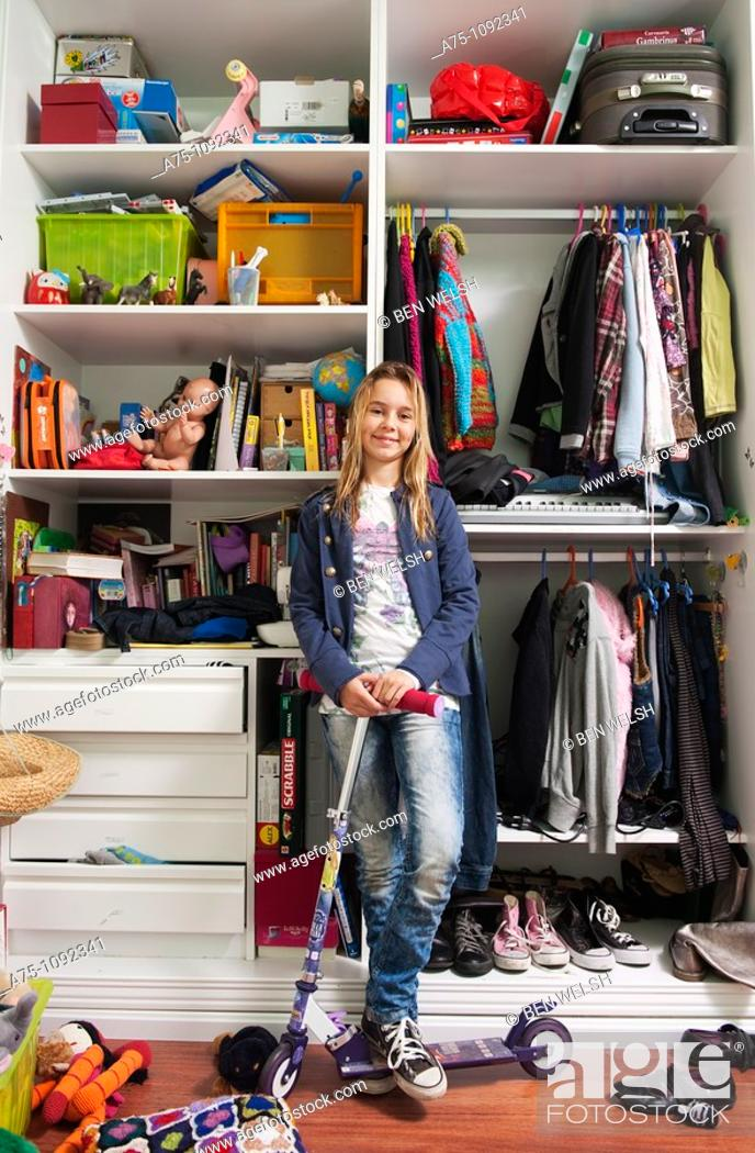 Stock Photo: Young girl in her bedroom.