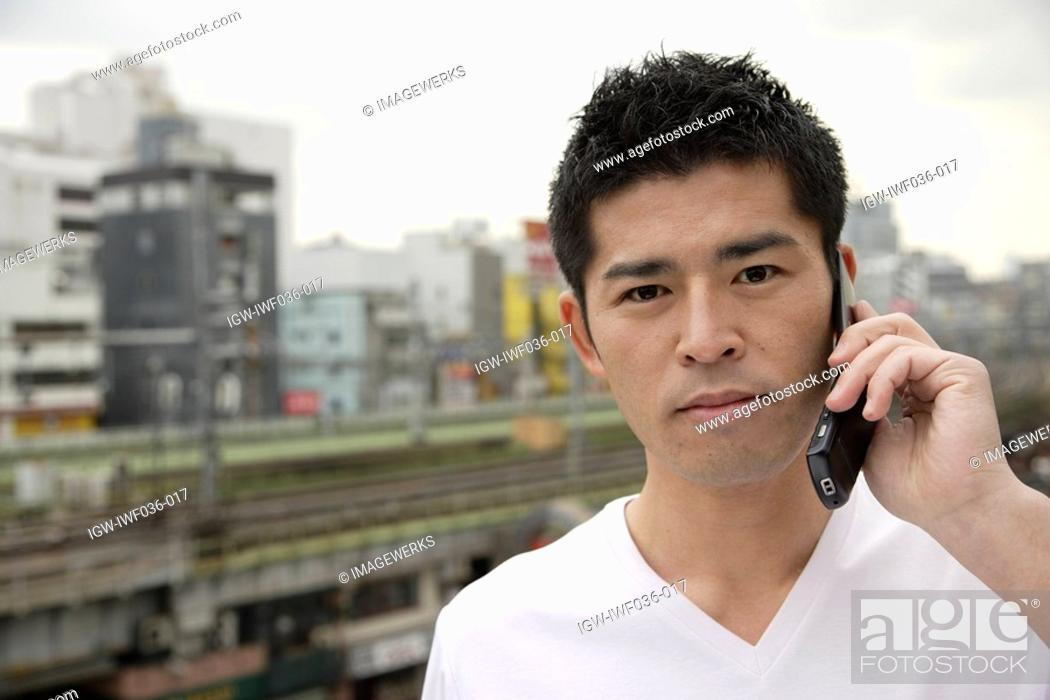 Stock Photo: A young man using cellphone.