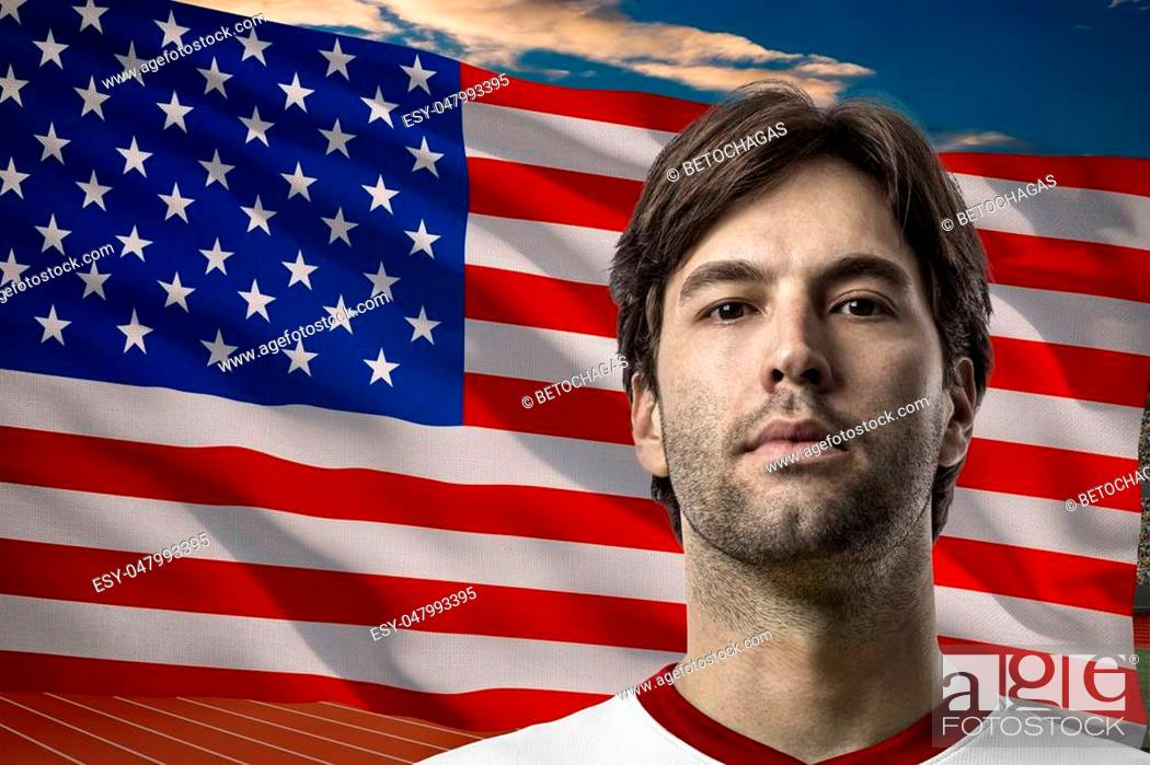 Photo de stock: American Athlete Winning a golden medal in front of a american flag.