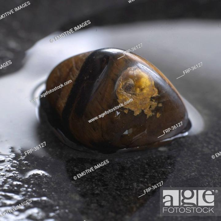 Stock Photo: Healing stone tiger's eye.