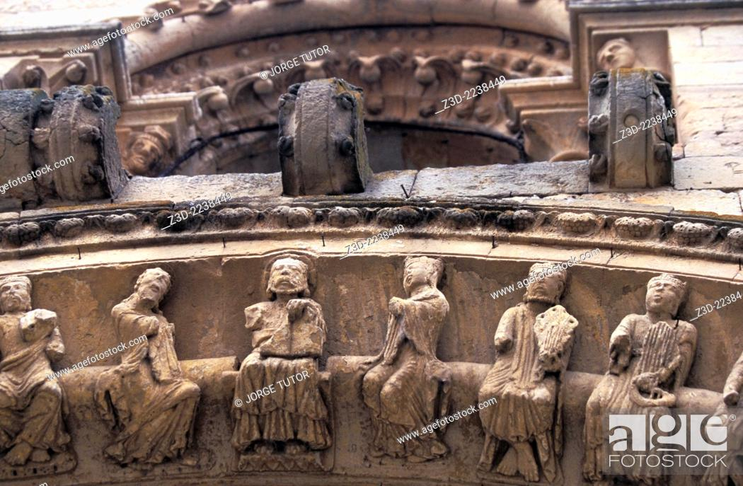 Stock Photo: Detail of the north gate arch of the church of Santa María la Mayor, transitional Romanesque architecture in Spain.