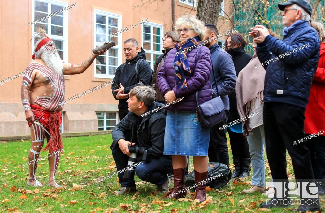 Stock Photo: dpatop - 28 November 2019, Saxony, Leipzig: Major Sumner, representative of the Australian Ngarrindejeri Community, conducts a smoking ceremony in the courtyard.