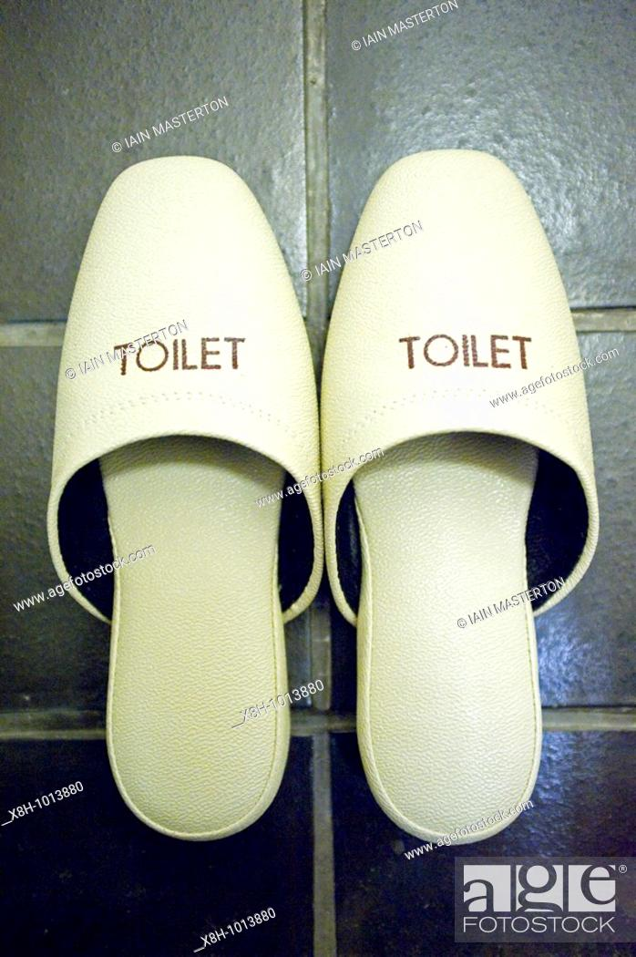 Stock Photo: Detail of special slippers to wear in toilet area in traditional Japanese hotel.