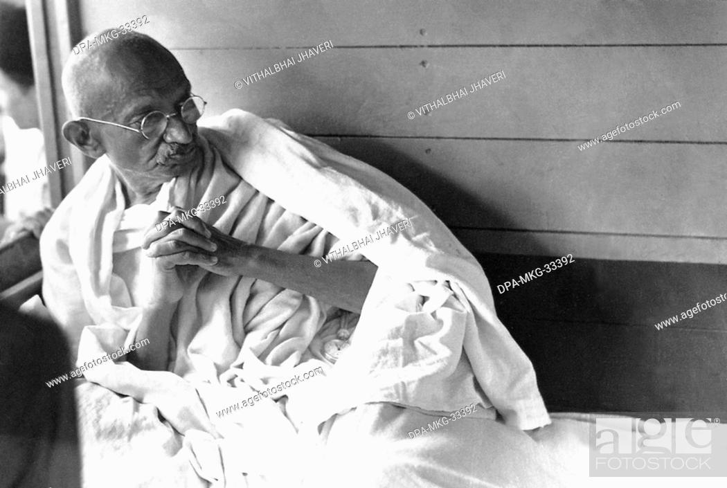 Stock Photo: Mahatma Gandhi in a train during his Harijan Tour in Gujarat, India, July 1934 - MODEL RELEASE NOT AVAILABLE.