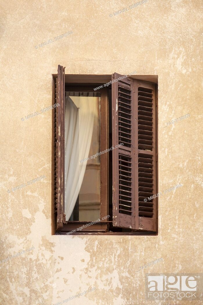 Stock Photo: Small Open Window With Shutters.