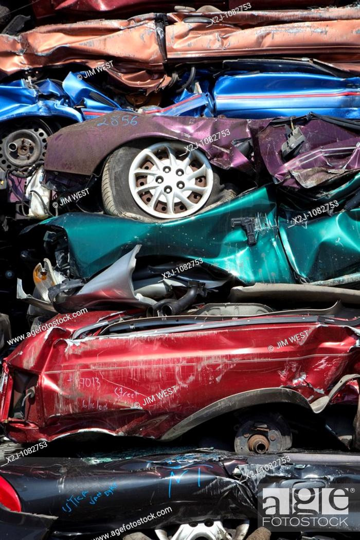 Stock Photo: Detroit, Michigan - Junk cars crushed and ready for recycling at a scrap yard.
