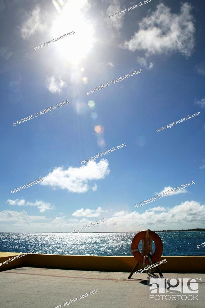 Stock Photo: A ring-buoy on a dock in the Island Cozumel, Caribbean.
