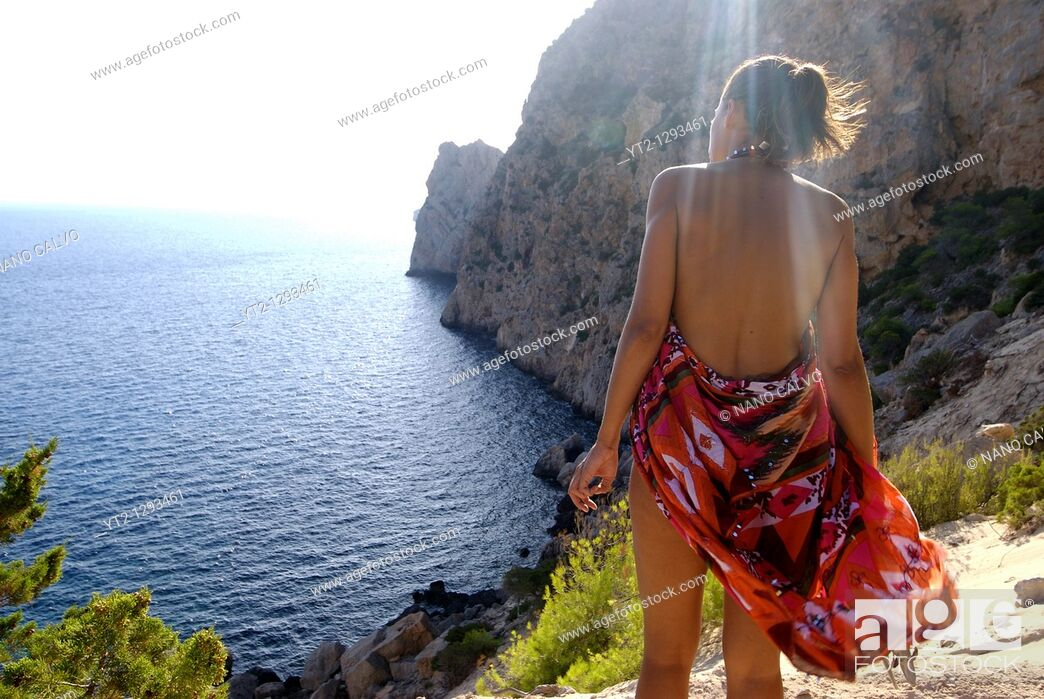 Stock Photo: Woman in Sa Pedrera des Savinar. Sa Pedrera des Savinar, also known as Atlantis, is an amazing place located in Ibiza, and not specified in any maps.