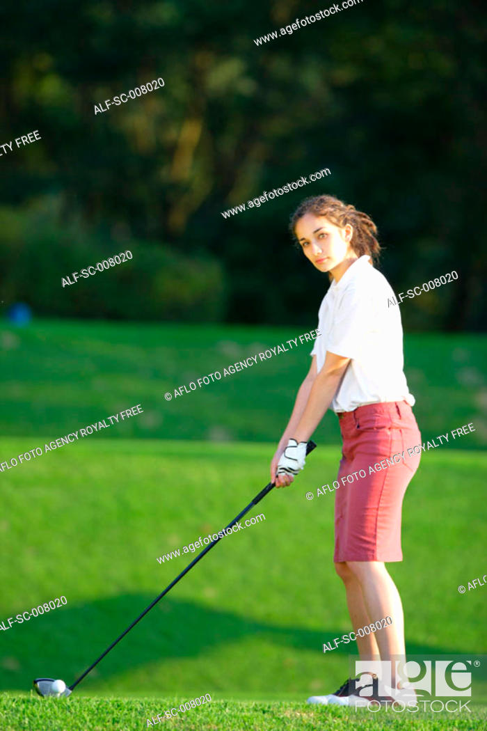 Stock Photo: A young woman contemplates before playing a shot.