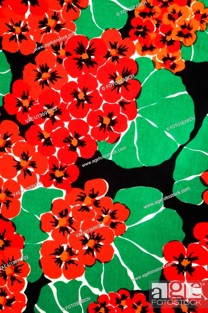 Stock Photo: Close-up of vintage fabric with vibrant red geraniums and green leaves printed on polyester.