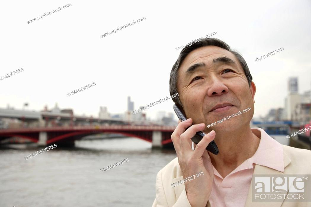 Stock Photo: Close-up of a senior man using mobile phone.