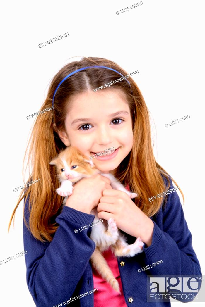 Stock Photo: Beautiful young girl posing with a lovely young kitten.