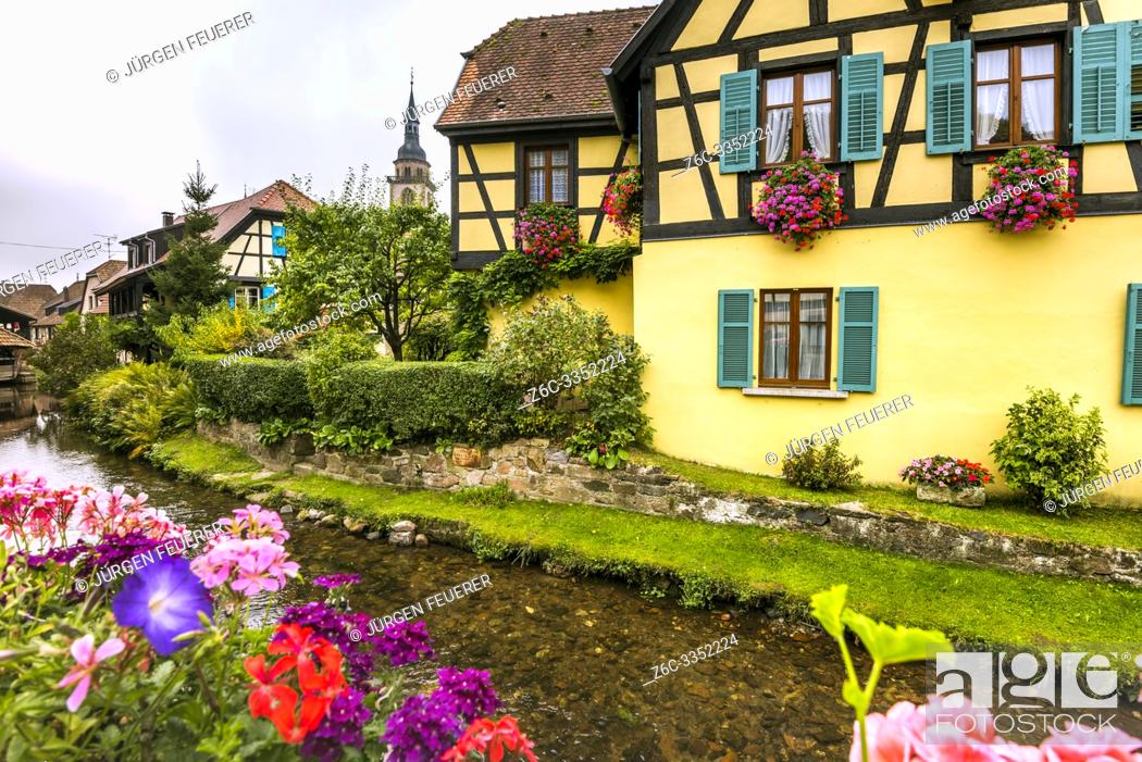 Photo de stock: old village Andlau, Alsace Wine Route, France, half-timbered houses and flower decoration at the brook side.