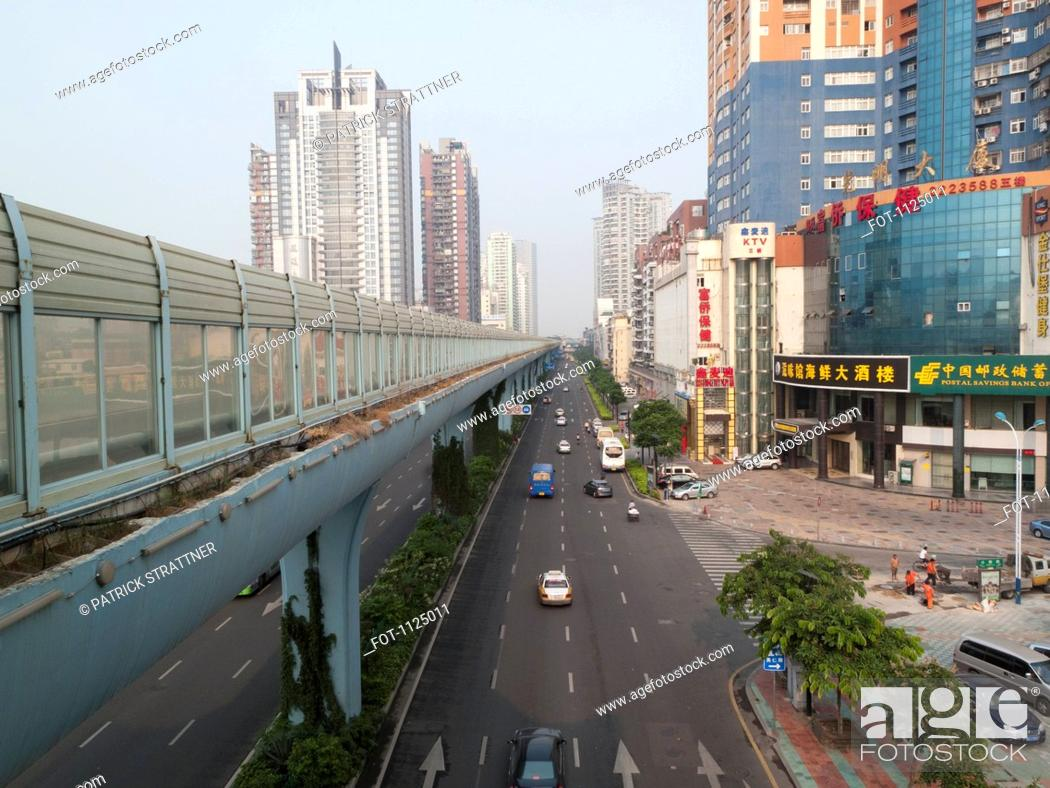 Stock Photo: Multiple lane one way street and skyline, Xiamen, China.