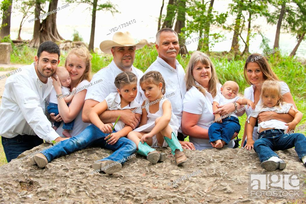 Stock Photo: Three generations family portrait, eleven people from babies to grandparents.