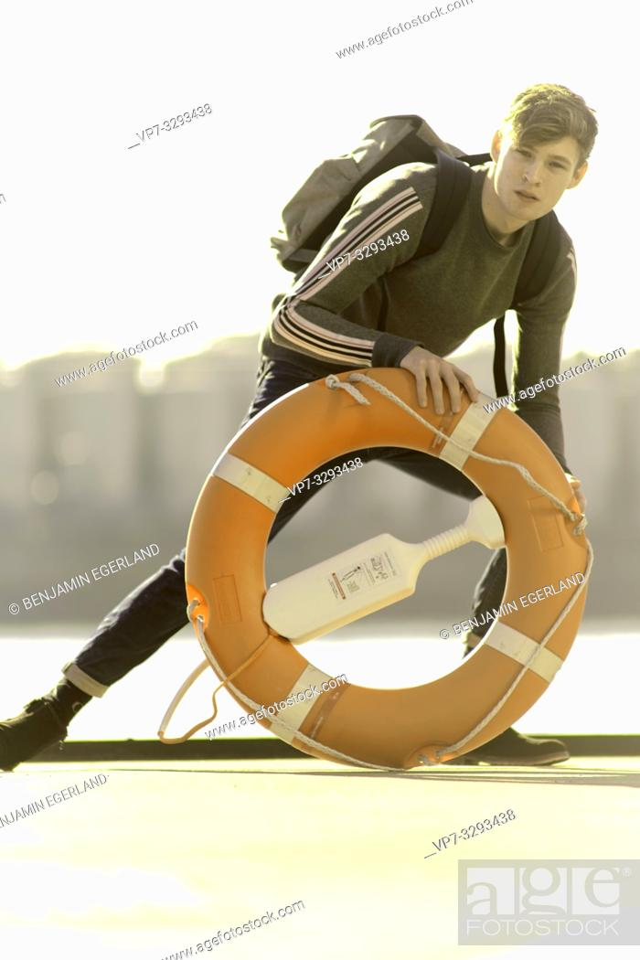 Stock Photo: young model man with lifebelt, in Hamburg, Germany.