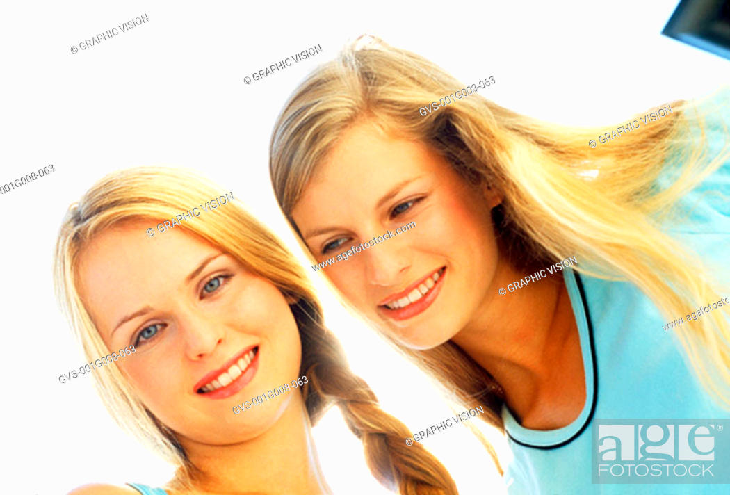 Stock Photo: Two young women smiling.