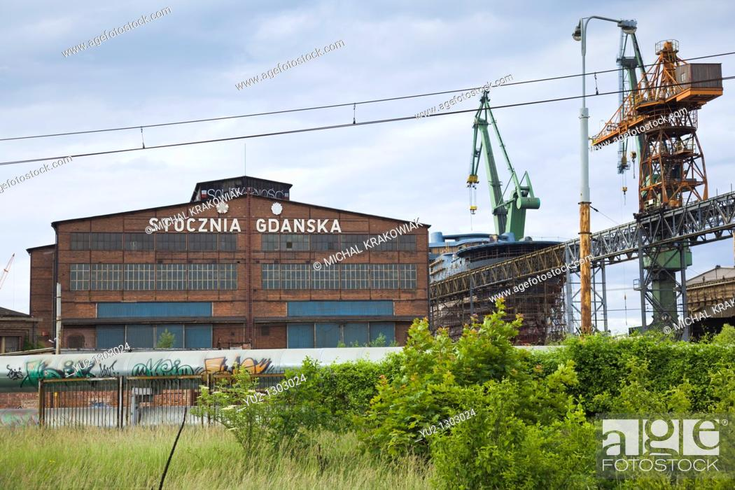 Stock Photo: Building of Shipyard of Gdansk with polish sign 'Shipyard of Gdansk' and writing 'Solidarnosc' on the roof.