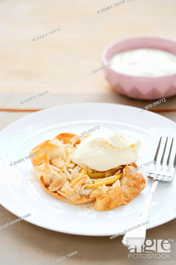 Stock Photo: Apple tart with filo pastry crust, almonds and cream.