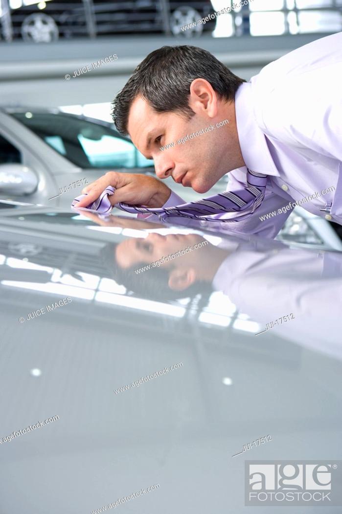 Stock Photo: Salesman shining car with tie.