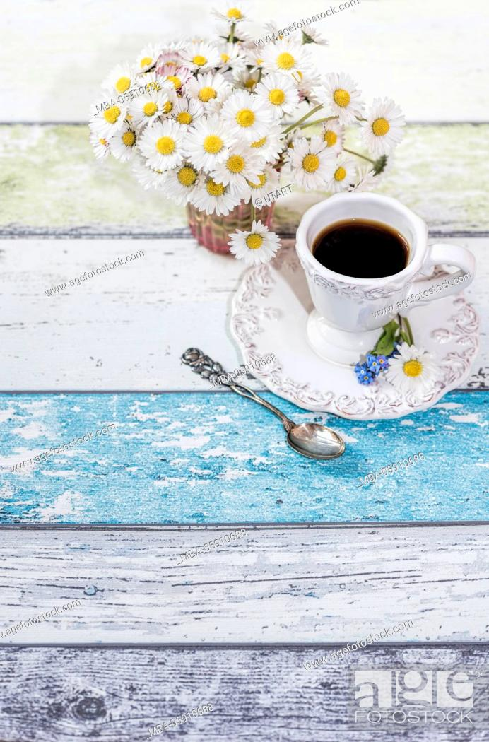 Stock Photo: Vase, bunch, daisy, wooden boards, arrangement, cup of coffee, silver spoons, forget-me-not blossoms,.