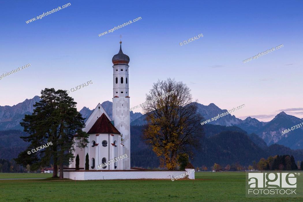 Stock Photo: Sunrise on St Coloman Church surrounded by woods. Schwangau, Fussen, Bavaria, Southwest Bavaria, Germany, Europe.