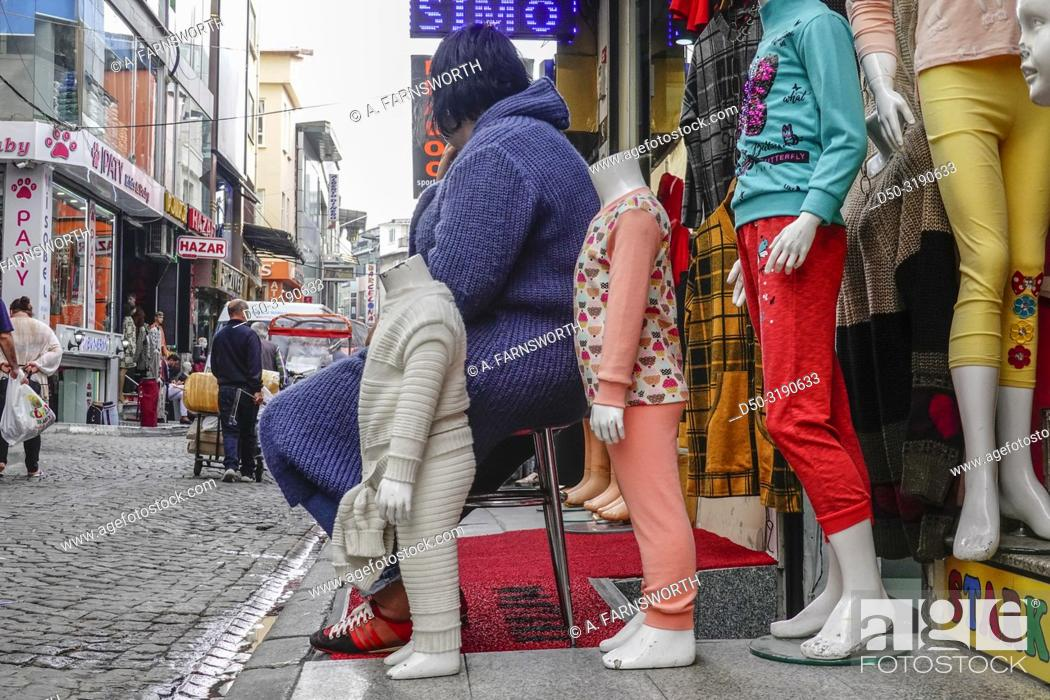 Istanbul, Turkey Pedestrians outside clothing stores in the