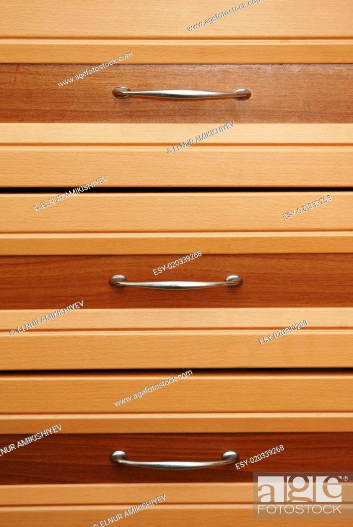 Photo de stock: Set of three wooden drawers.