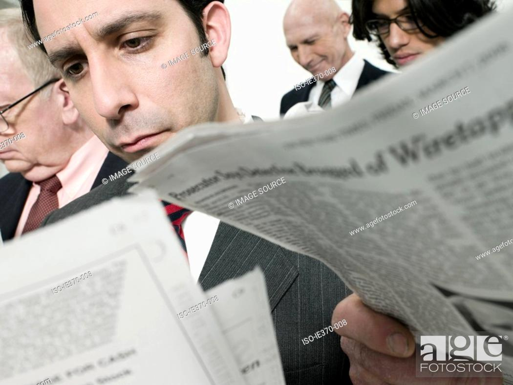 Stock Photo: Businessmen reading newspapers.