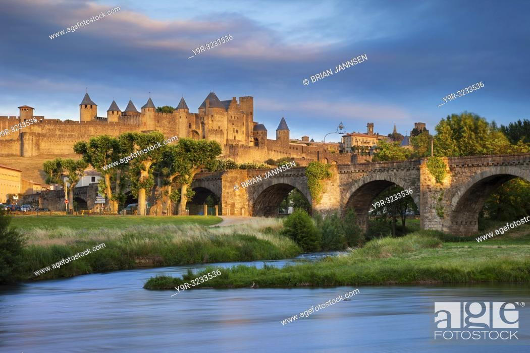 Stock Photo: Setting sunlight over town of Carcassonne and River Aude, Languedoc-Roussillon, France.