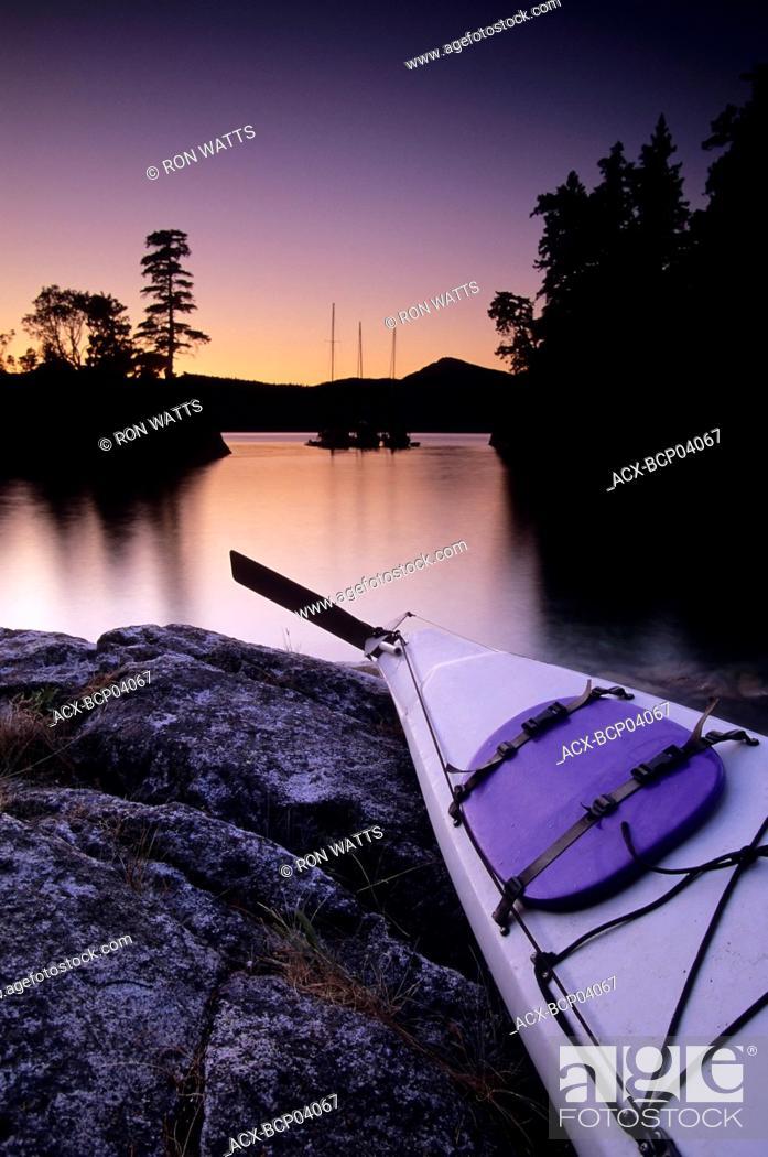 Stock Photo: Kayak and Yachts at dusk in Desolation Sound Marine Park, Curme Island, British Columbia, Canada.