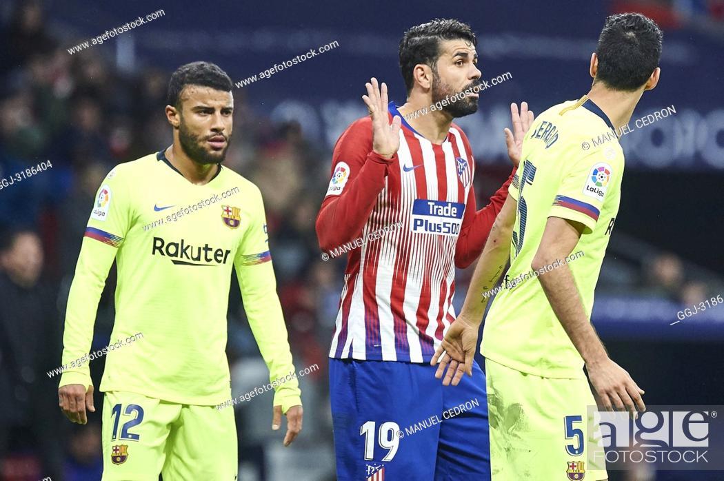 Stock Photo: Diego Costa (forward; Atletico Madrid), Rafinha (midfielder; Barcelona), Sergio Busquets (midfielder; Barcelona) before La Liga match between Atletico de Madrid.