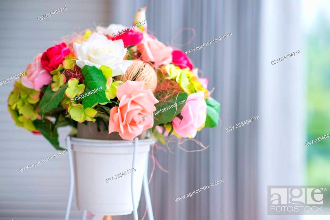 Stock Photo: Colorful rose flower in pot.