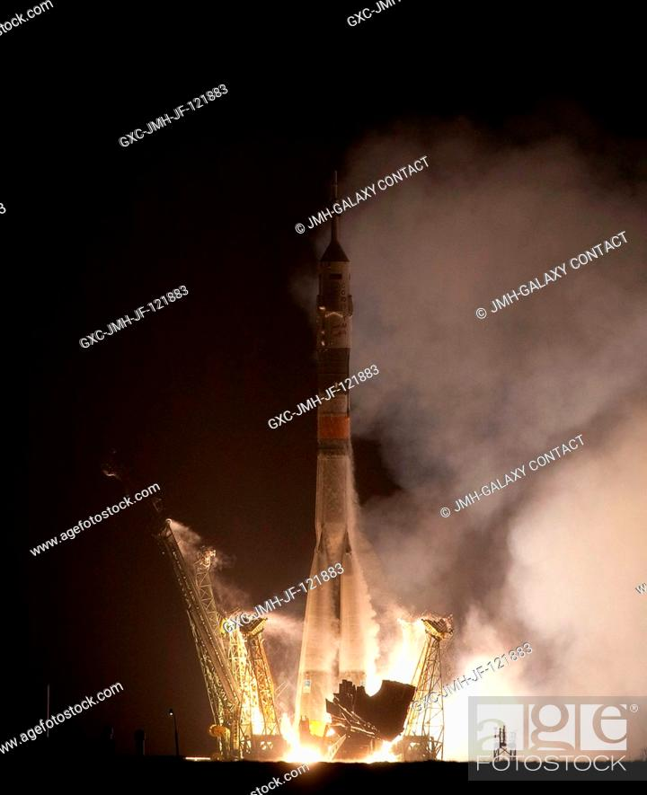 Stock Photo: The Soyuz TMA-17 rocket launches from the Baikonur Cosmodrome in Kazakhstan on Dec. 21, 2009, carrying Expedition 22 NASA Flight Engineer T.J.
