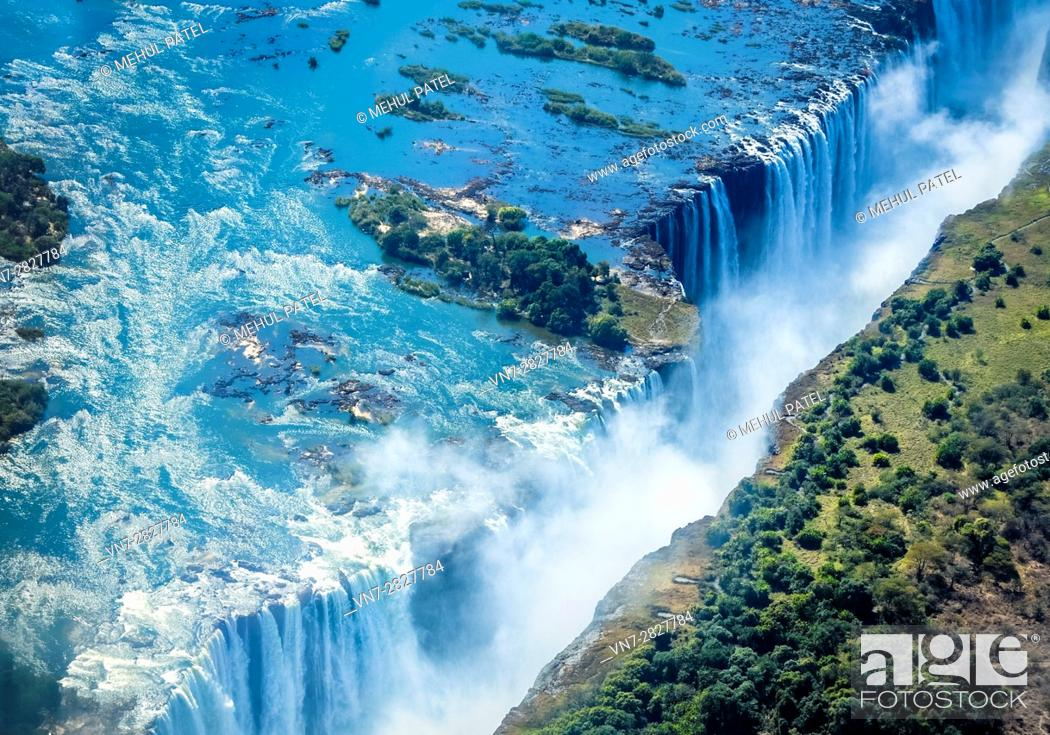 Stock Photo: Aerial shot looking over Victoria Falls, the natural border of countries Zambia and Zimbabwe, Africa.