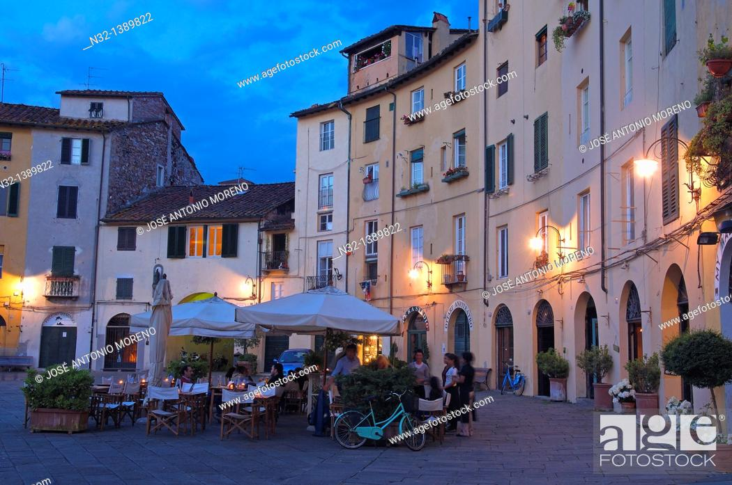 Stock Photo: Lucca, Anfiteatro square at Dusk, Piazza Anfiteatro, Tuscany, Italy.