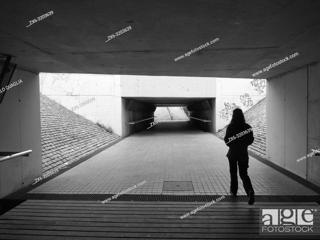 Stock Photo: Young woman at railroad underground pathway. Mataro city. Maresme region, Barcelona province, Catalonia, Spain.