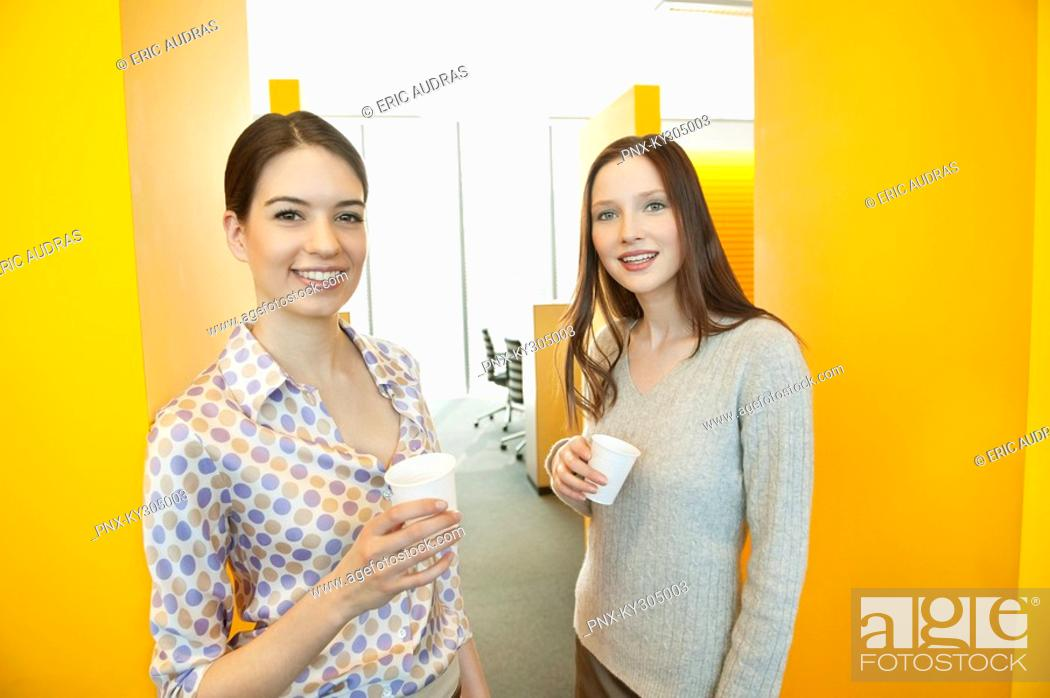 Stock Photo: Businesswomen drinking tea in an office.