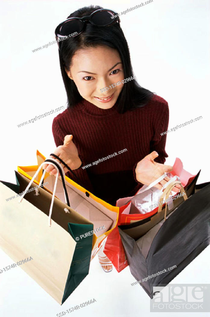 Stock Photo: High angle view of a young woman carrying shopping bags.