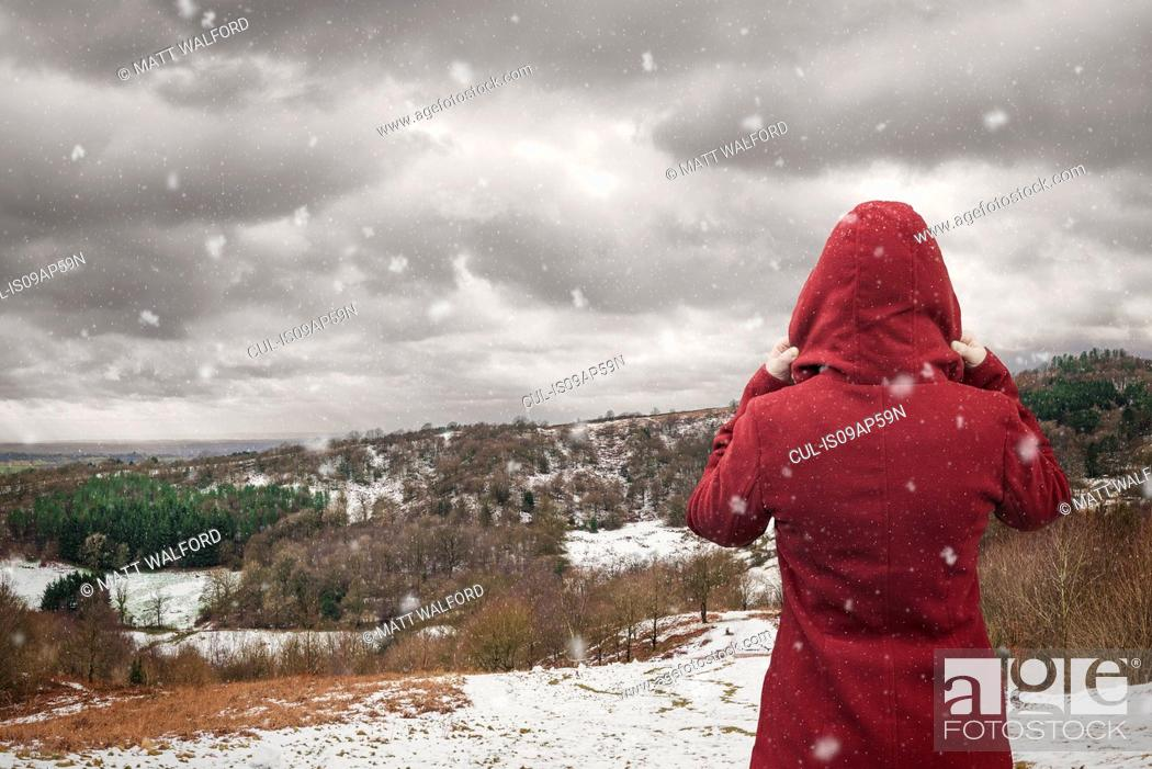Stock Photo: Backview of woman looking at landscape, Clent Hills, Worcestershire, UK.