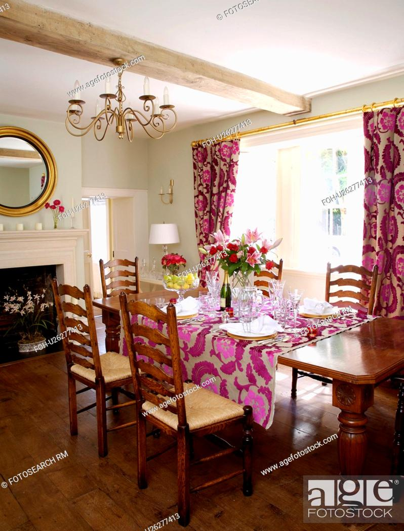 Great Stock Photo: Ladderback Chairs At Table Set For Lunch In Country Dining Room  With Pink