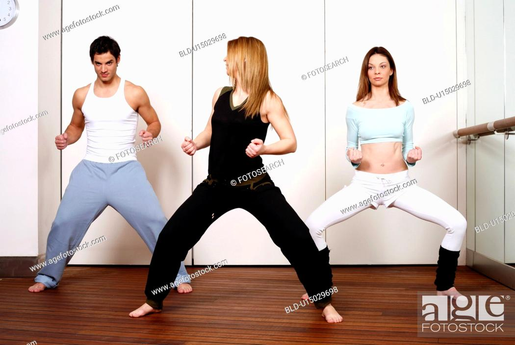Stock Photo: Students in an Active Tae Bo class, waist down.