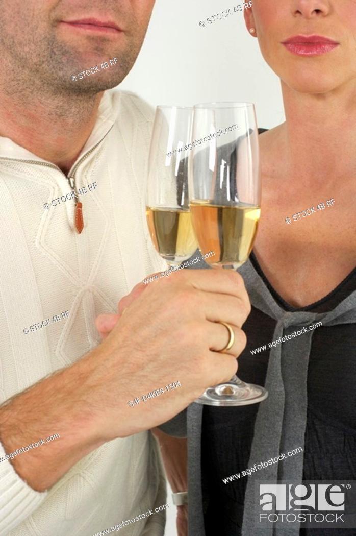 Stock Photo: Couple celebrating with sparkling wine.