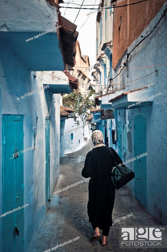 Stock Photo: Woman walking, Chefchaouen, Morocco.