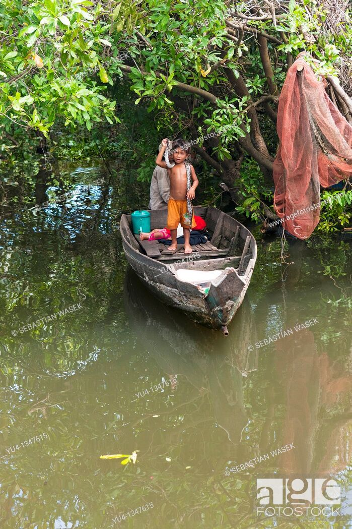 Stock Photo: Boys with snakes  Floating village  Tonle Sap Lake  Near Siem Reap  Cambodia  Southeast Asia  Indochina.