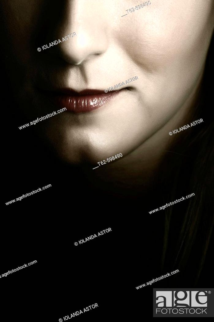 Stock Photo: Young woman's face. Smile detail.